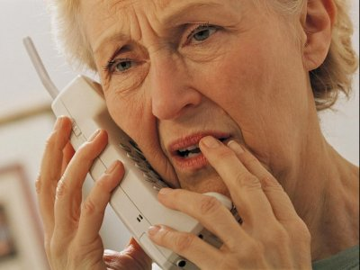 Worried Senior Person on Phone